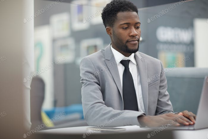 Successful African Businessman at Work