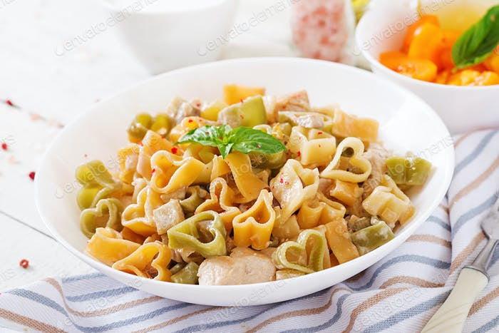Creamy pasta with chicken and eggplant  served in deep plate. Italian food.