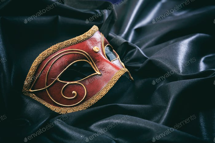 Carnival mask isolated on black satin background