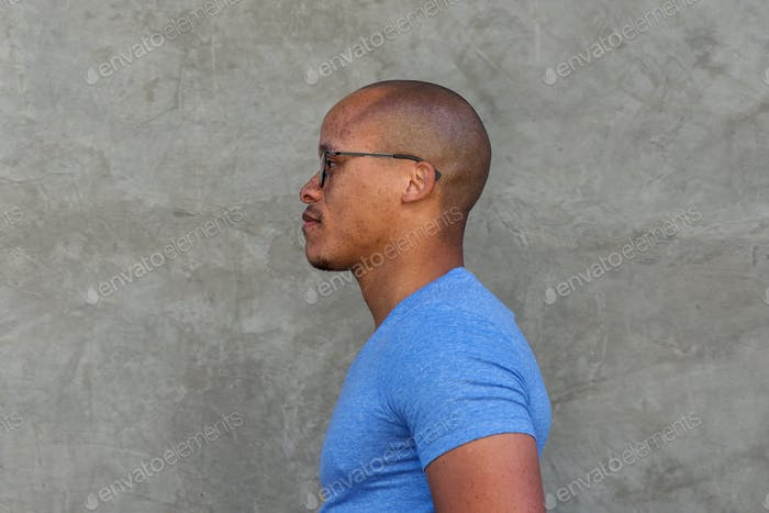 Side portrait of serious african man with glasses