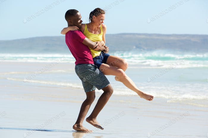 Loving young couple having fun on the beach