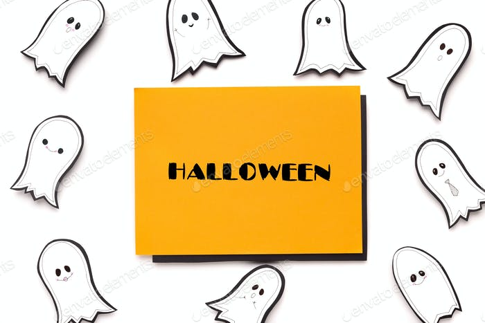 Halloween text on orange sheet of paper on background
