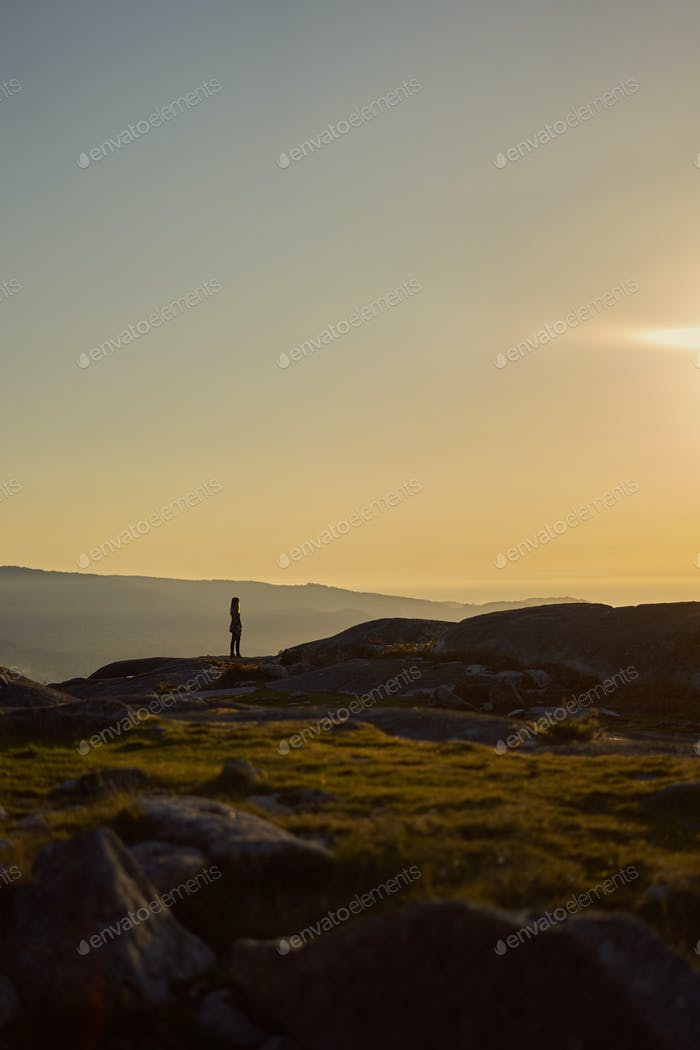 Silhouette of a person contemplating the landscape from Mount Galiñeiro in Vigo, Spain