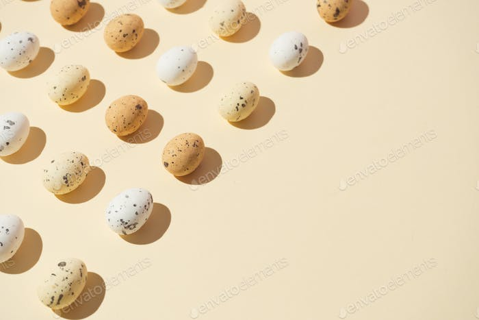 Easter eggs on pastel yellow background. Easter holiday concept. Minimal composition.