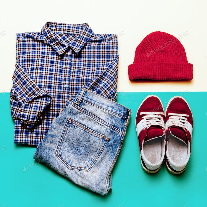 Urban clothing set. Plaid shirt, jeans, shoes cap