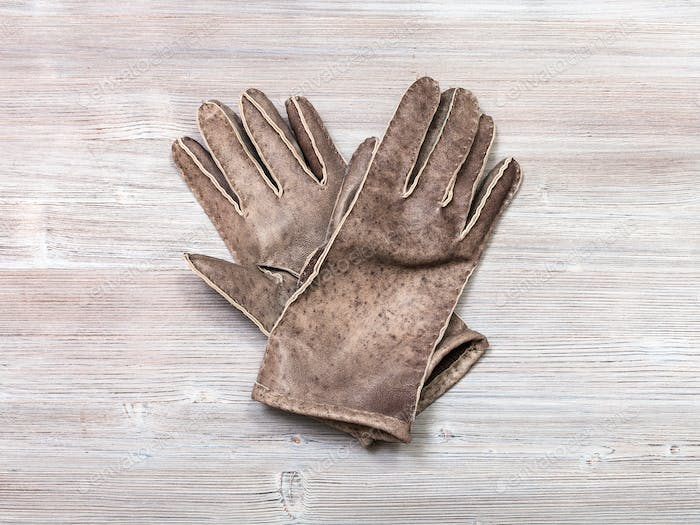 new hand-made leather gloves on table