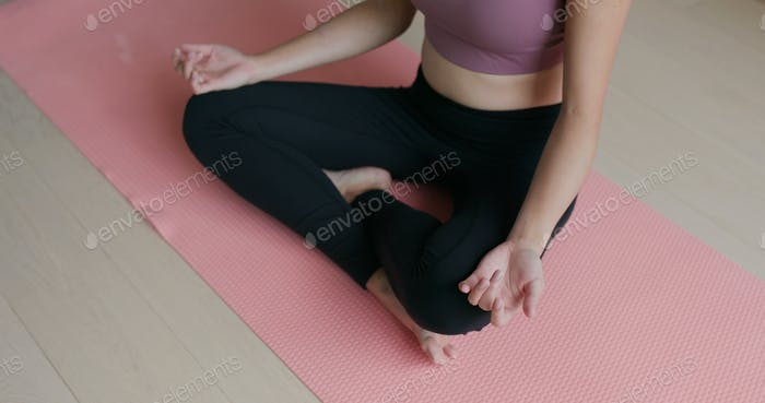 Woman do yoga at home