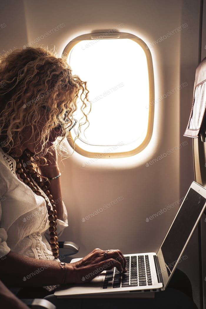 Beautiful woman travel on airplane flight
