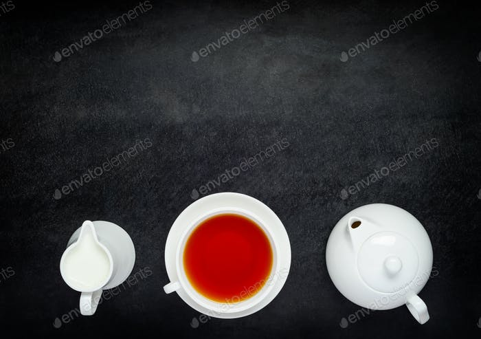 teapot with Cup Tea and Milk on Copy Space Area