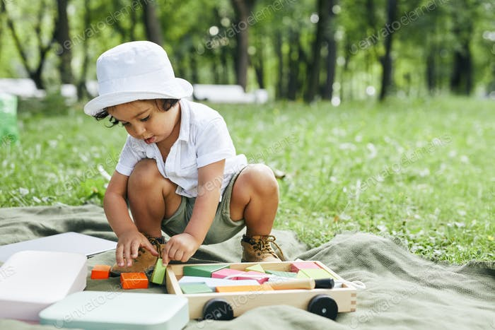 Toddler Boy Playing in Park