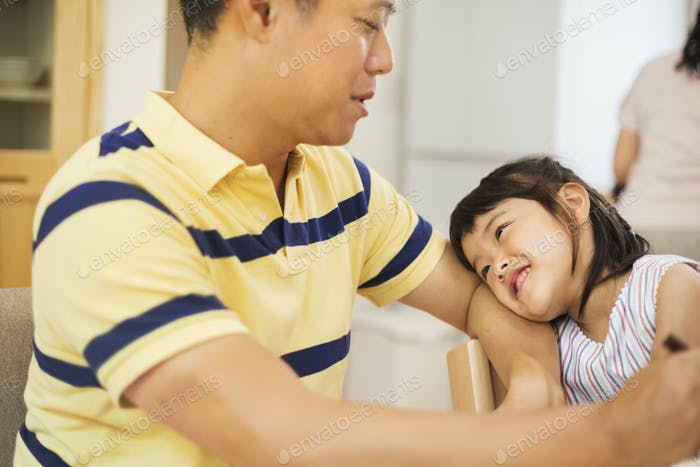 Family home. A man and his daughter.