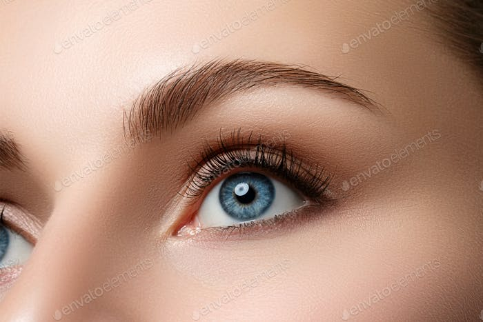 Close up view of beautiful blue female eye