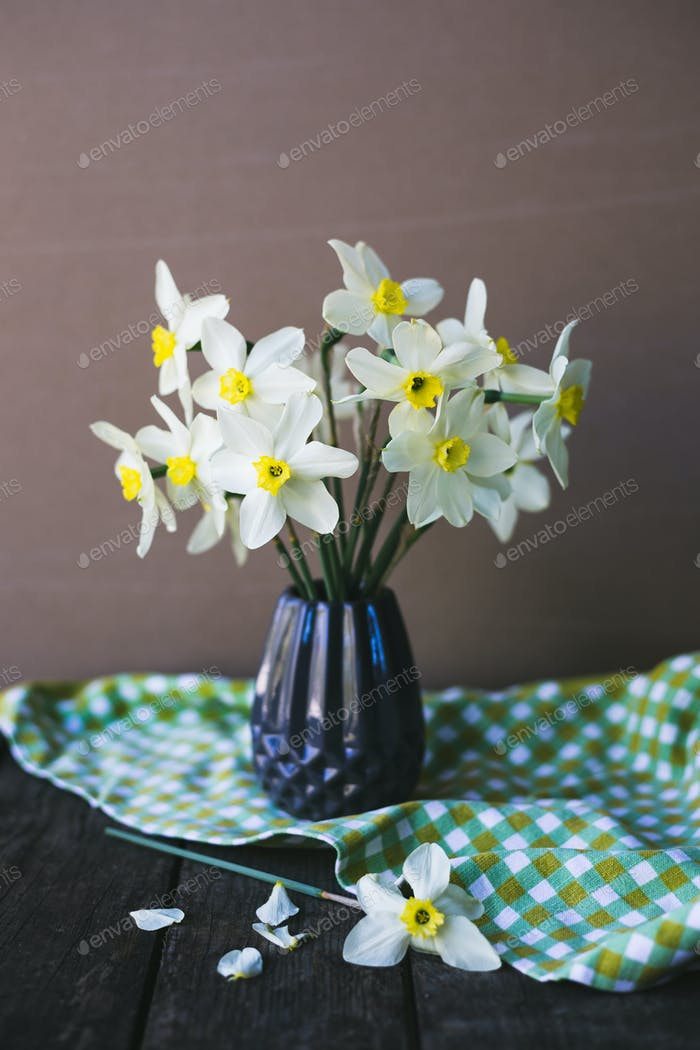 Narcissus in vase on an old background