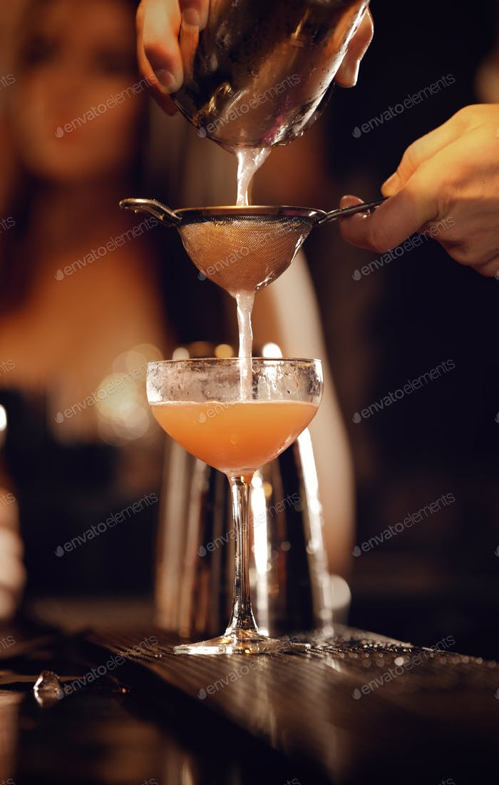 Bartender with Shaker Pouring Wine