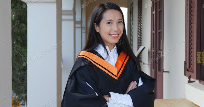 Asian woman get graduation in university campus