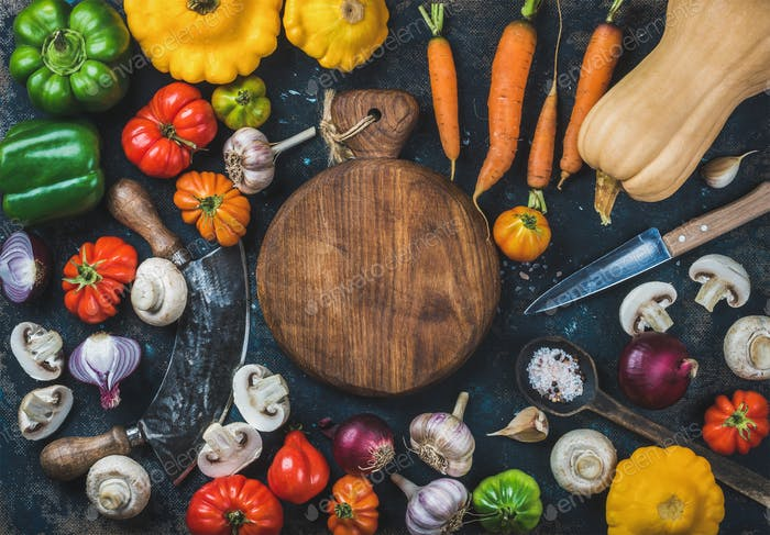 Fall harvest vegetable ingredients and knives for healthy cooking