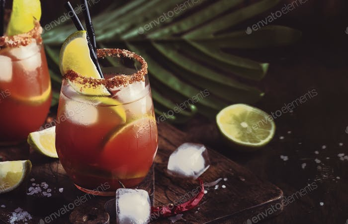 Mexican inspired bloody mary alcoholic cocktail with beer, lime juice, tomato juice