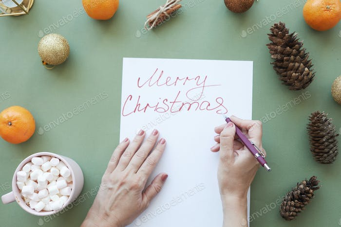 Signing Christmas card