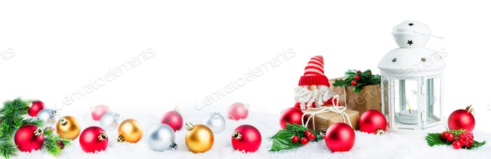 Christmas lantern with gifts, colored balls and Santa Claus on s