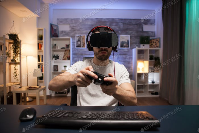 Pov of online shooter gamer wearing virtual reality goggles