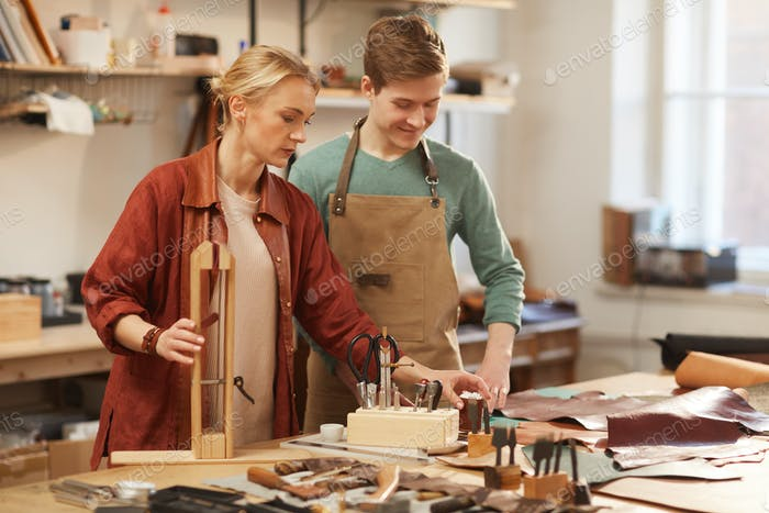 Man And Woman In Workshop