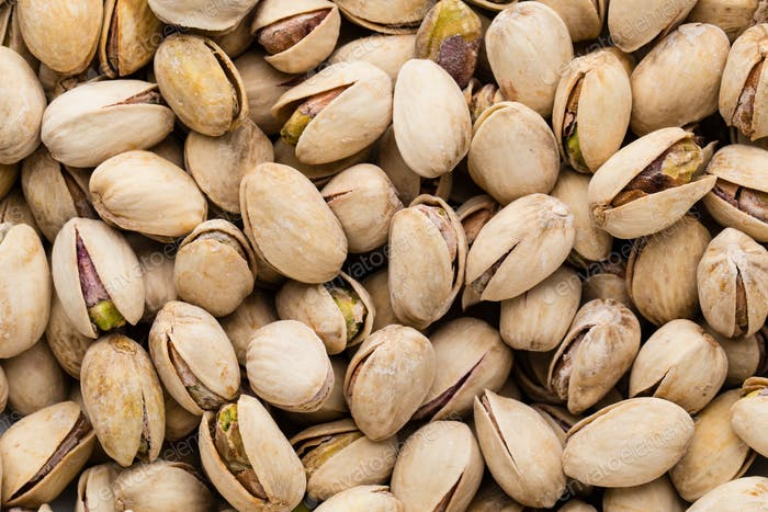 Roasted and salted pistachios in shell.