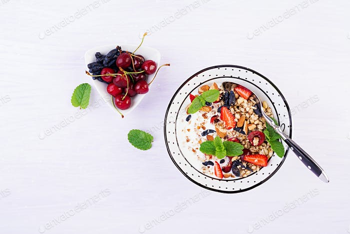 Thumbnail for Healthy breakfast - granola, strawberries, cherry, honeysuckle berry, nuts and yogurt