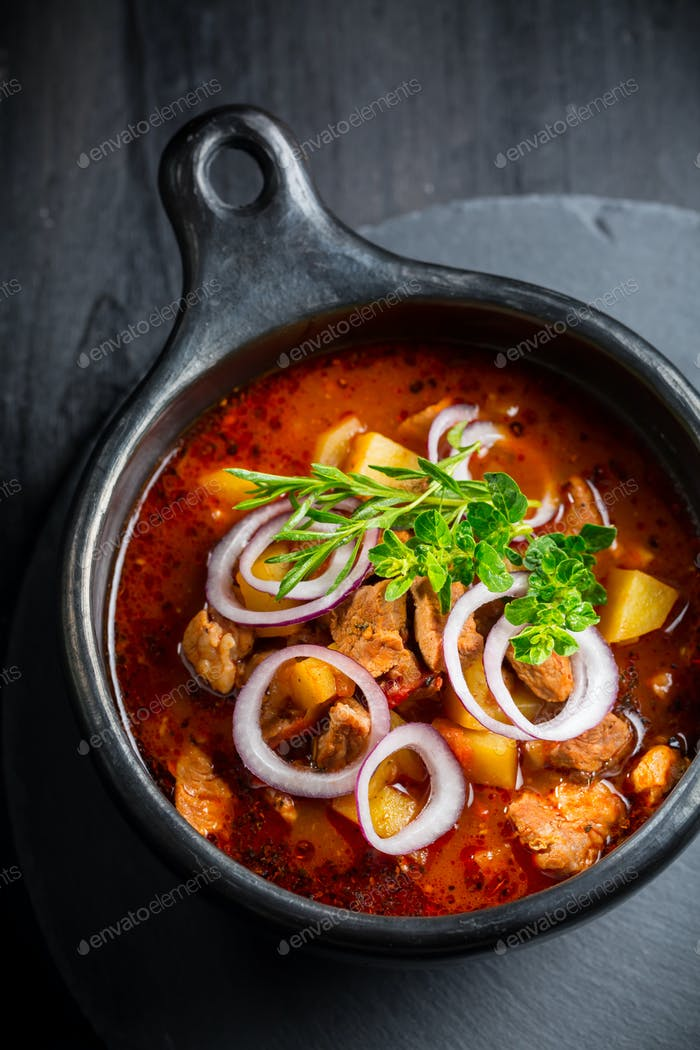 Traditional Hungarian goulash - stew of meat and vegetables with onions