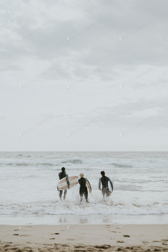 Surfers going into the water