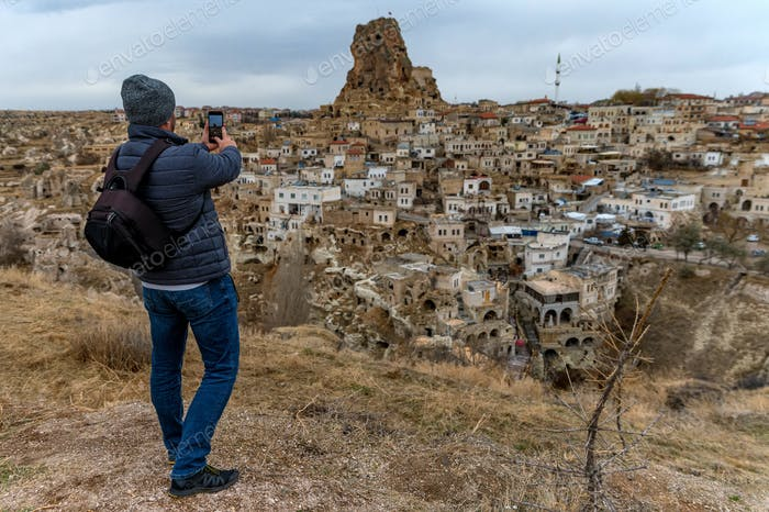 Male hiker takes photo of Unesco World Heritage, Cappadocia, Turkey