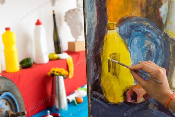 Female painter drawing in art studio
