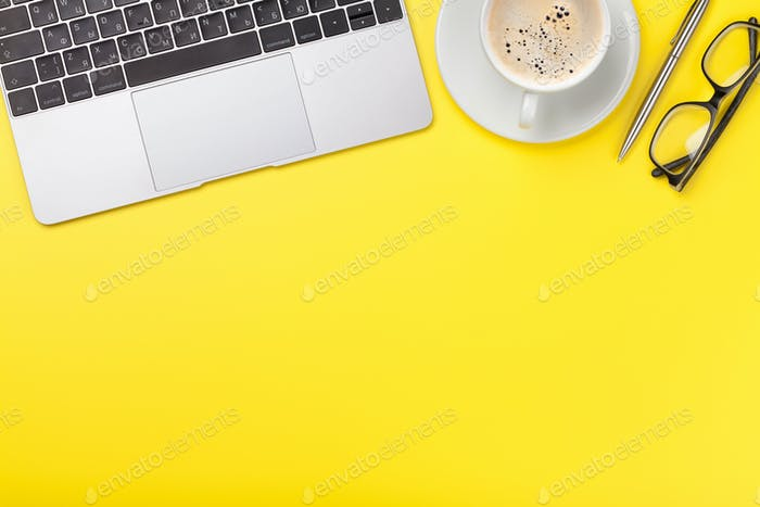 Office yellow workplace with coffee cup, supplies and computer