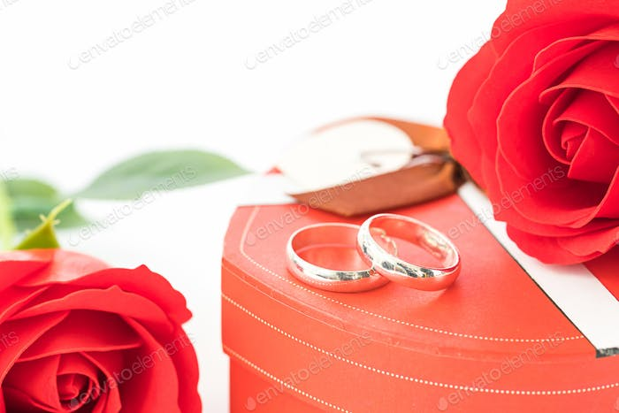 Red rose and heart-shaped box on white_-6