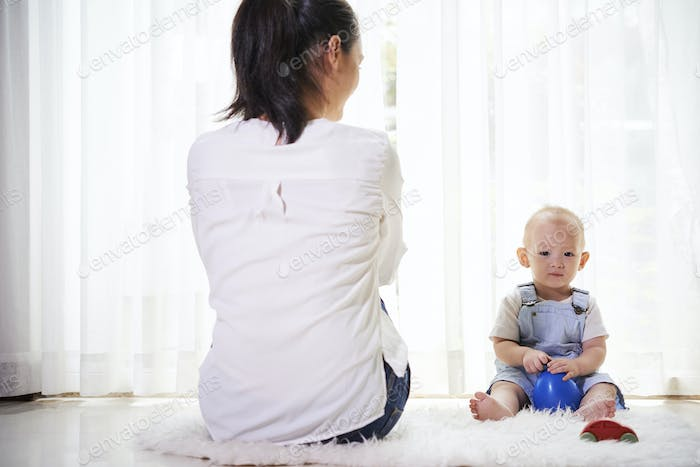 Mother and son spending time at home