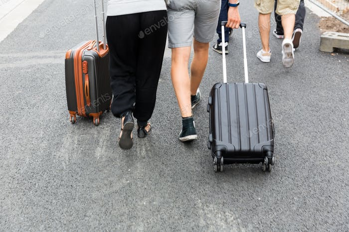 Group of tourists with suitcases, Europe tourism