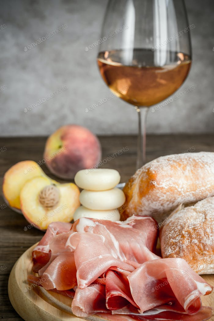 White wine with prosciutto and ciabatta