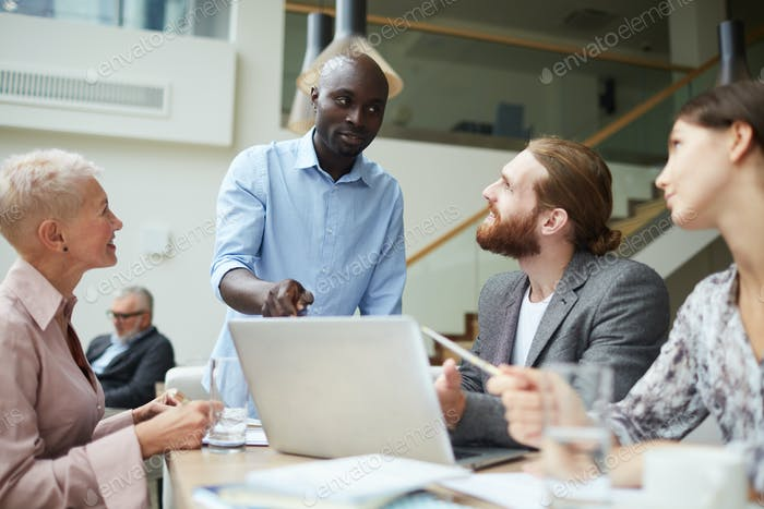 African Businessman Leading Meeting