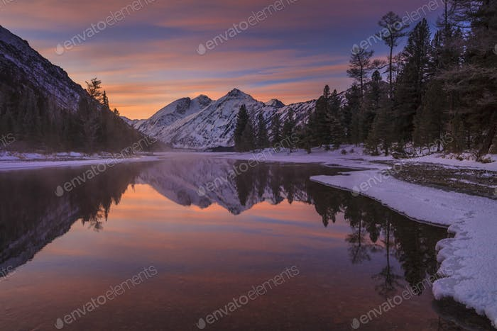 Scenic winter landscape on the background of a beautiful sunset