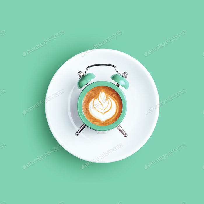 Alarm Clock with Dial of Cappuccino on Mint Background.
