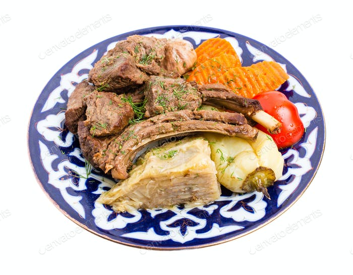 Baked lamb meat with stewed vegetable mix.