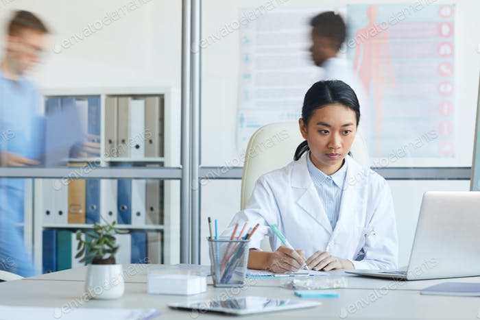 Female Doctor Using Computer in Clinic