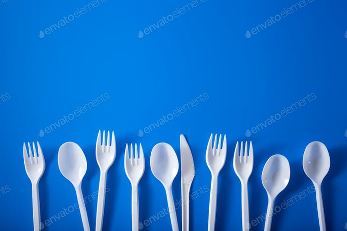 single use plastic forks, spoons. concept of recycling plastic,