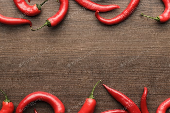 Red Hot Chilli Peppers On Wooden Table