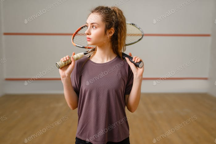 Female player with squash racket in action
