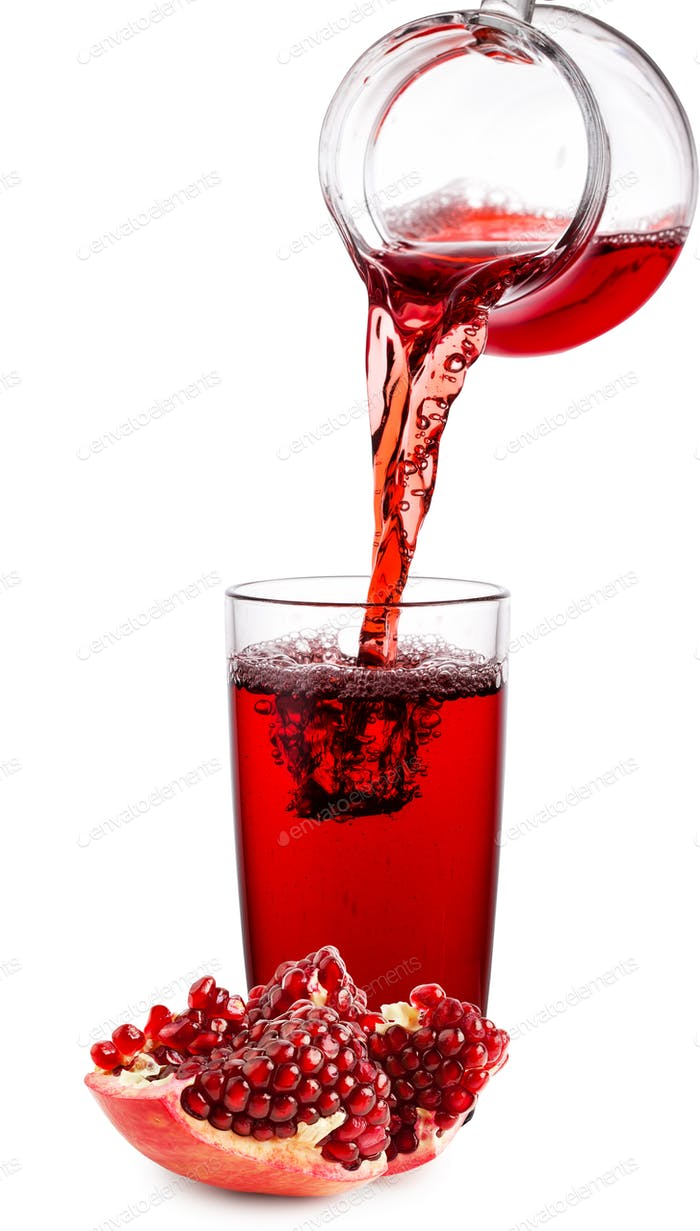 Pomegranate juice poured from jug into glass