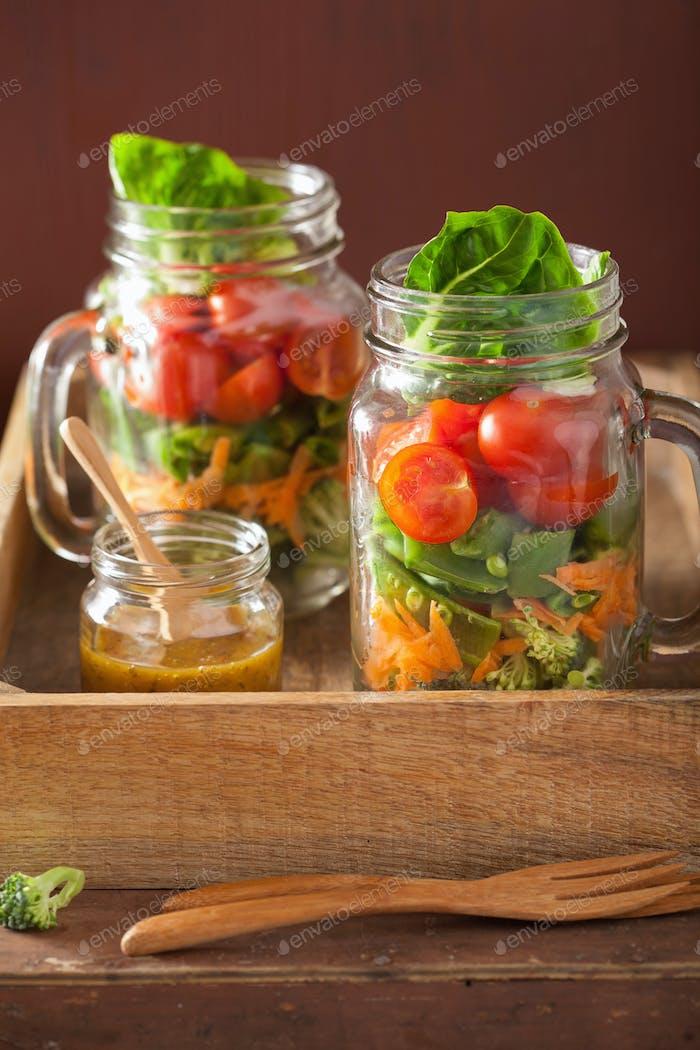 healthy vegetable salad in mason jar. tomato, broccoli, carrot,