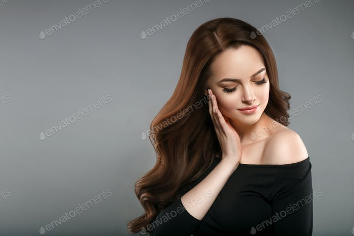 Brunette long beautiful hairstyle female hands touching face portrait