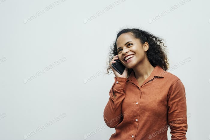 Young lady talking on the phone