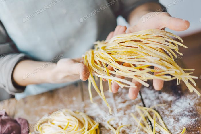 Chef making fresh italian pasta