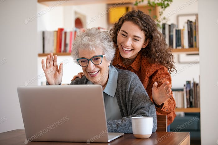 Grandmother and granddaughter doing video call with laptop